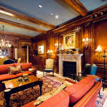 Raised paneling, crown molding, ceiling beams, arched doors by Interior Concepts